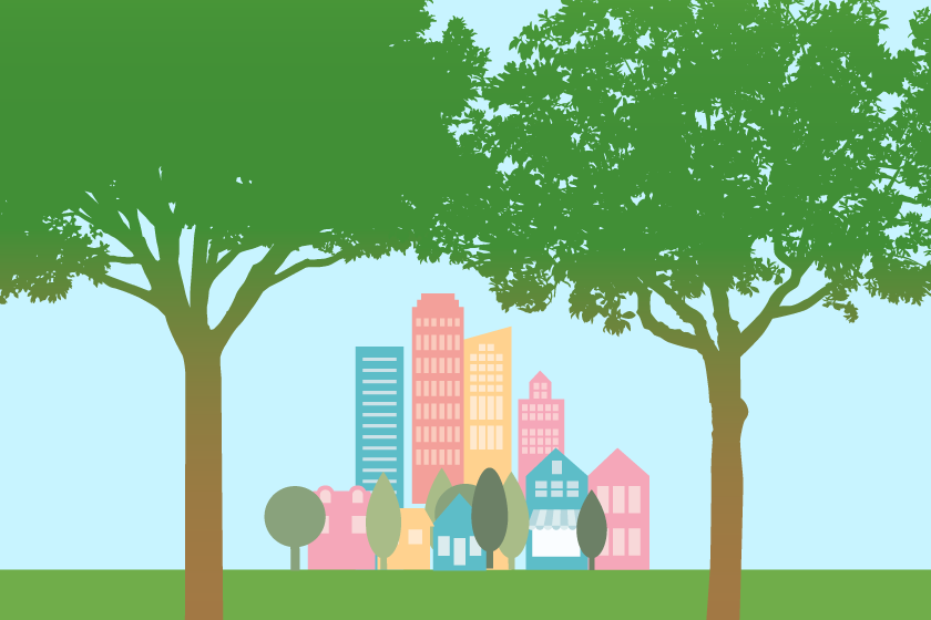 A city skyline is shaded by trees.
