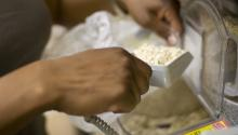 Hands scooping ingredients out of a bulk bin