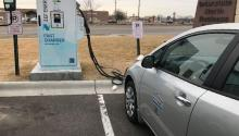 Electric verhicle being charged at a charging station