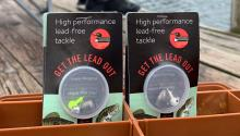 "Close up of lead-free fishing tackle in package that says ""Get the lead out"" and has red circle with loon graphic."