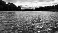 Black and white view of Minnesota river with clouds
