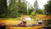 two people in canoe on Rainy River