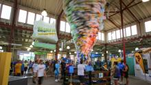 Bagnado, a large spinning tornado made from plastic shopping bags, at the 2015 Eco Experience exhibit