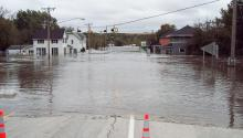 Main street of a small town completely flooded with water.