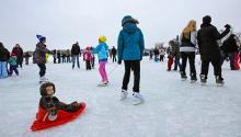 People skating on a lake in winter