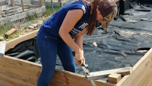 GreenCorps member Angela LaCroix at work building gravel nurseries for growing trees.