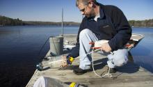 Scientist with water quality measurement gear.