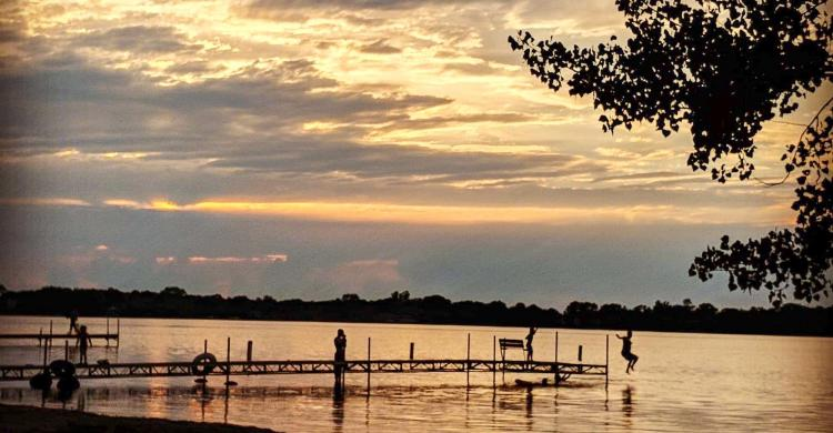Lake Waverly at dusk with a dock in silhouette