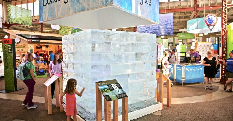 Giant ice block with child touching side