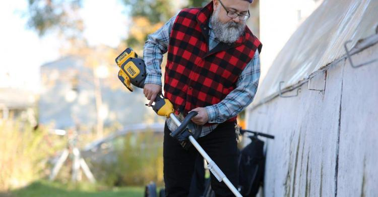 Jose Luis Villasenor with electric lawn trimmer
