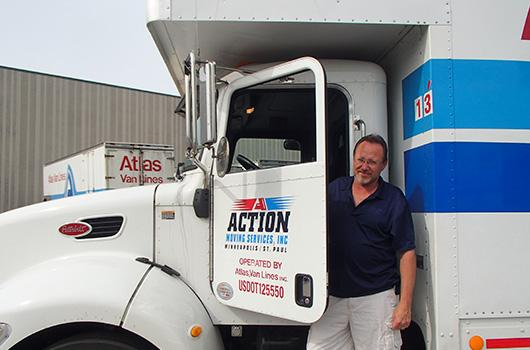 Ken Volbert of Action Moving stands with his new truck.