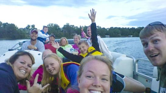 Several members of the Berg family on a pontoon boat.