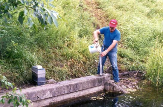 Gerald Erickson, monitoring Pine River water quality.