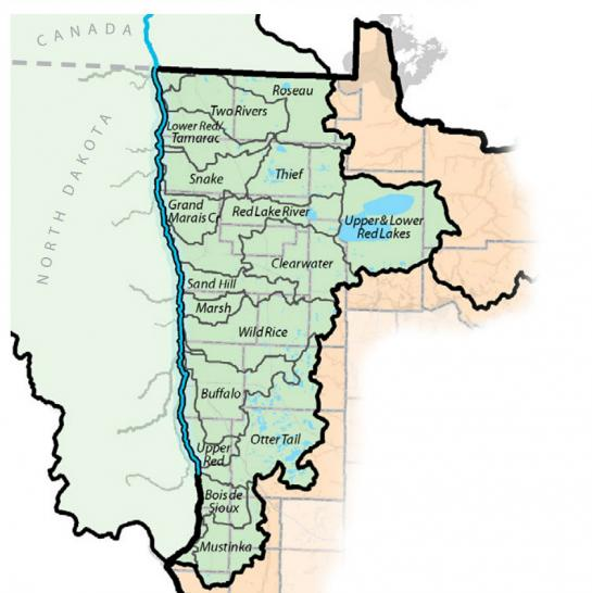 Map showing the location of the 17 watersheds that make up the Red River Basin in the northwest corner of Minnesota, bordered to the north by Canada and to the west by the Red River of the North and North Dakota.
