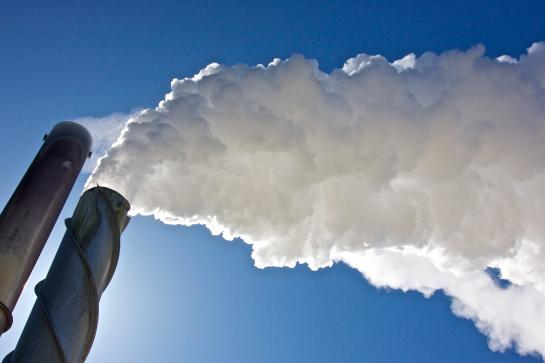 Smoke stacks emitting clouds of steam