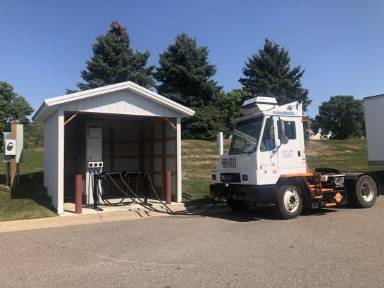 Electric terminal tractor and charging station