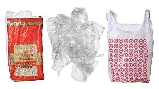 two plastic bags and plastic film against a white background