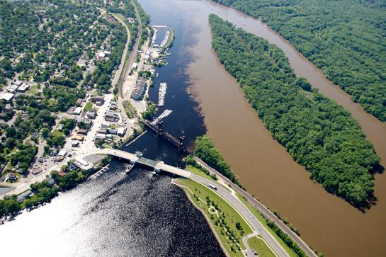 An aerial view showing the clear water of the St Croix River flowing into the muddy water of the Mississippi River