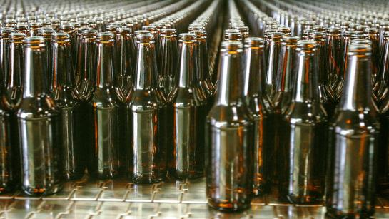 Rows of brown glass bottles