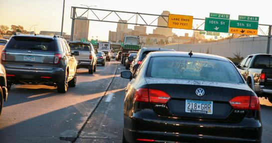 Heavy traffic on freeway driving into a city