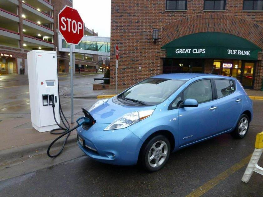 Electric car charging at a station