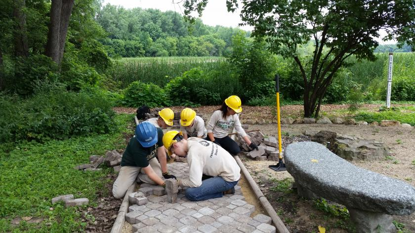 High school students creating a water pervious path in Richfield