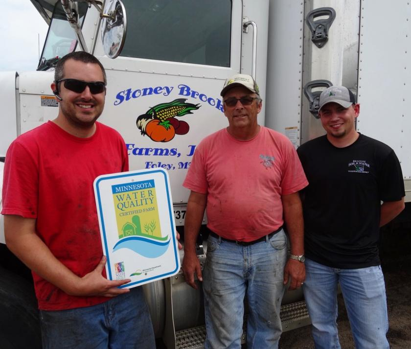 Brad & Mark Chmielewski of Stoney Brook Farms, Inc. accepting their MN Ag Water Quality Certification Program signage. Pictured Left to Right: Brad & Mark Chmielewski; Casey Gwost – Benton SWCD District Technician