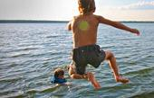 boy-jumps-into-lake