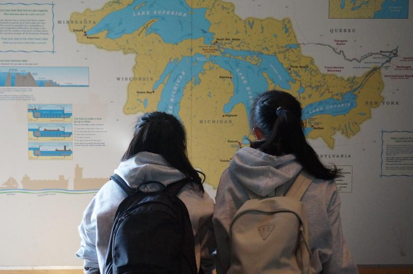 Students look at a map of the Great Lakes.
