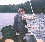 Collecting a sample of lake water