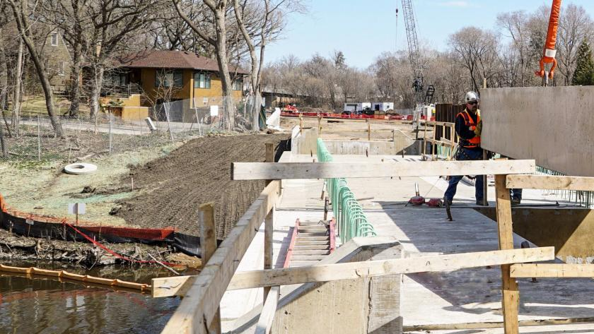 Best management practices on a construction site protect a stream bank from erosion along the route of the Southwest Green Line Light Rail Transit Extension