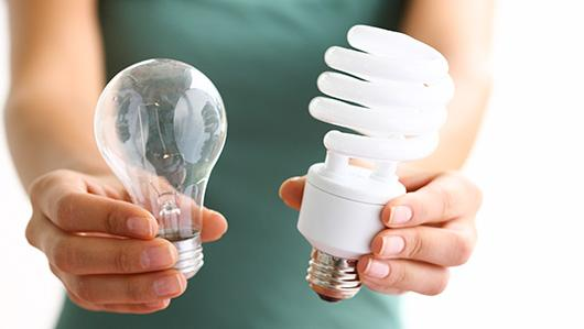 hands-holding-incandescent-CFL-bulbs