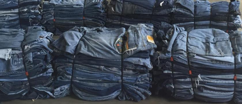 bales of jeans bundled for shipping