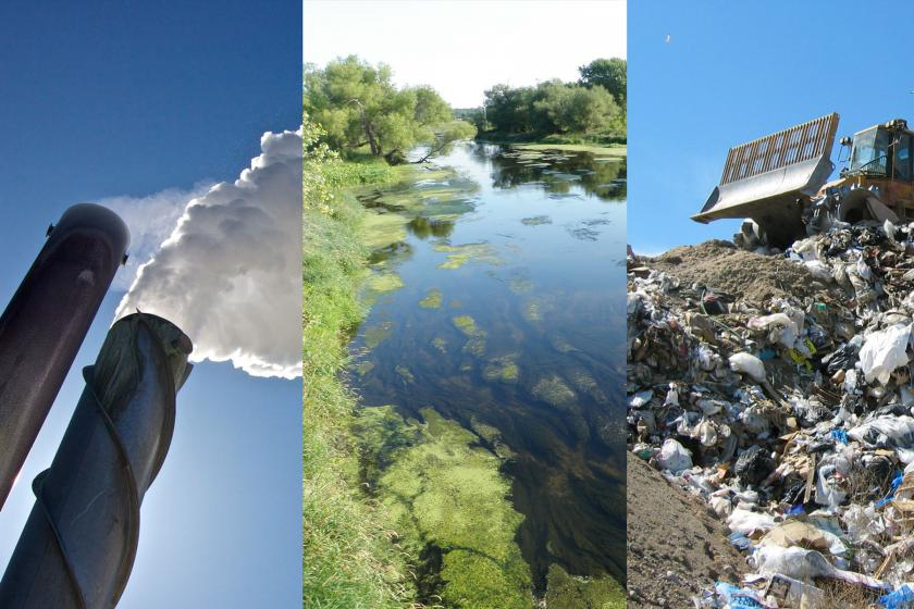 smoke stack with steam coming out of it, a river green with algae, a landfill