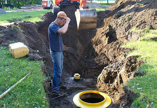 man-looking-at-septic-system