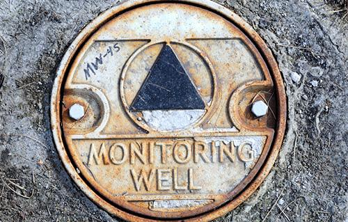 Close up of metal monitoring well cap