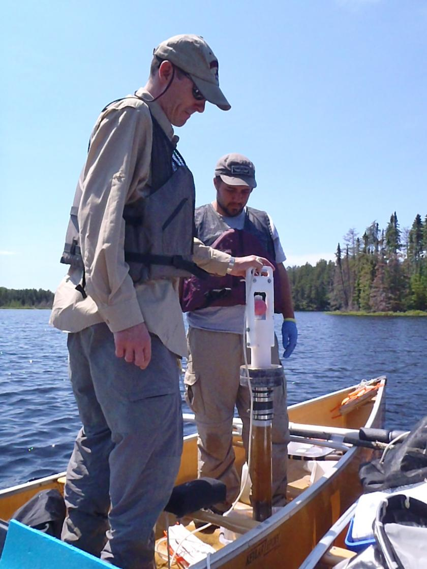 Taking a sediment core from bottom of lake
