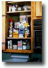 Cupboard containing household hazardous wastes