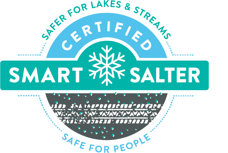 Logo for certified smart salter showing white tire track on black background with light blue specks representing salt.