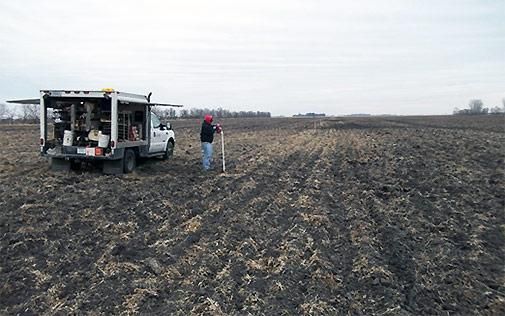 Examining land for spreading contaminated petroleum compounds.