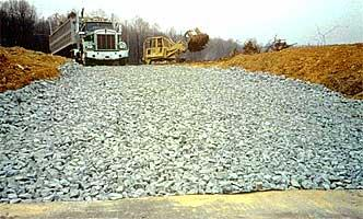 A stabilized construction exit, made of rock keeps mud from vehicle tires off public roads