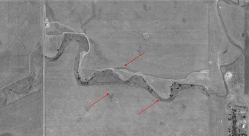 Aerial photographs from 1938, red arrows indicated natural bends (sinuosity)  within the stream