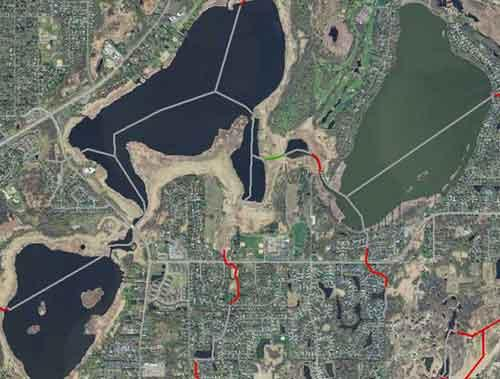 An example of a series of wetlands/small lakes near Circle Pines,  MN, the National Hydrography Dataset (NHD) stream line-work does not represent  a stream and therefore the altered watercourse designation is no definable  channel.