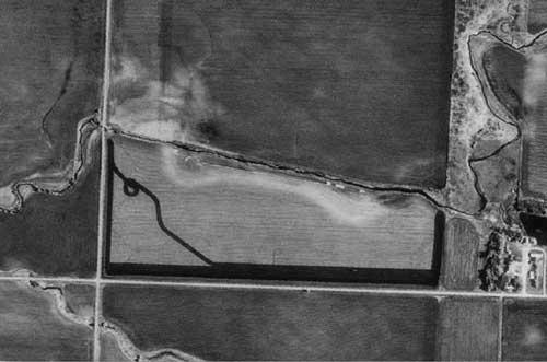 1991 leaf-off satellite imagery. Note  that the natural bends from the 1938 aerial photographs no longer are connected  to the stream
