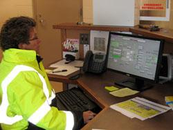 Colleen Thompson, superintendent, checks the computer monitoring the operation of the new Willmar wastewater treatment plant.