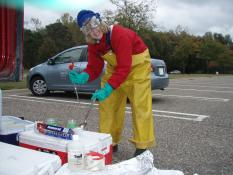 Dr. Crane leaning over sediment testing kit in the field