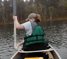 A volunteer uses the integrated sampler to collect water for phosphorus and chlorophyll samples