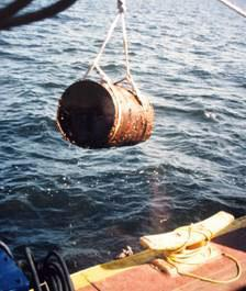 Rusty barrel being lifted out of Lake Superior