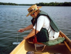 Volunteer uses a Secchi disk to test water transparency