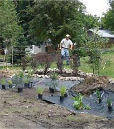 Rain garden being planted in a resident's yard along the Sauk River.